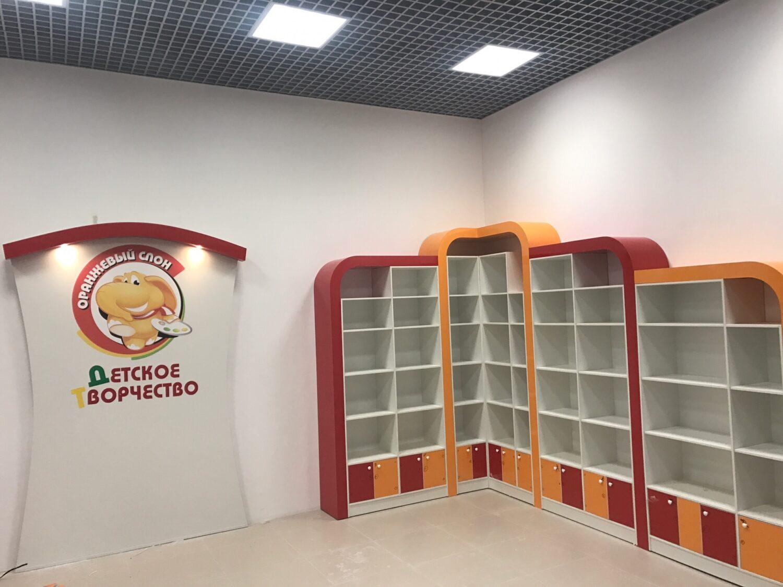Логотип Оранжевый слон и красно оранжевый шкаф